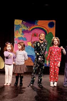 four children on stage