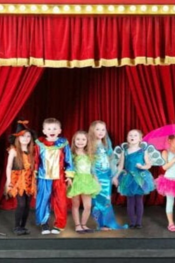 toddlers in costume on stage