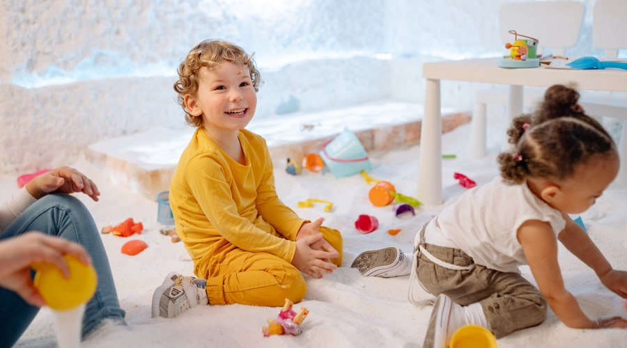 toddler in yellow outfit smiling