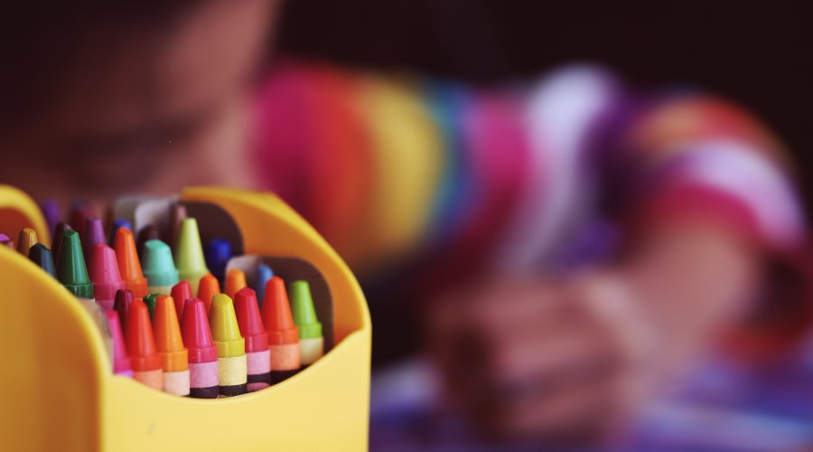 colourful crayons in box