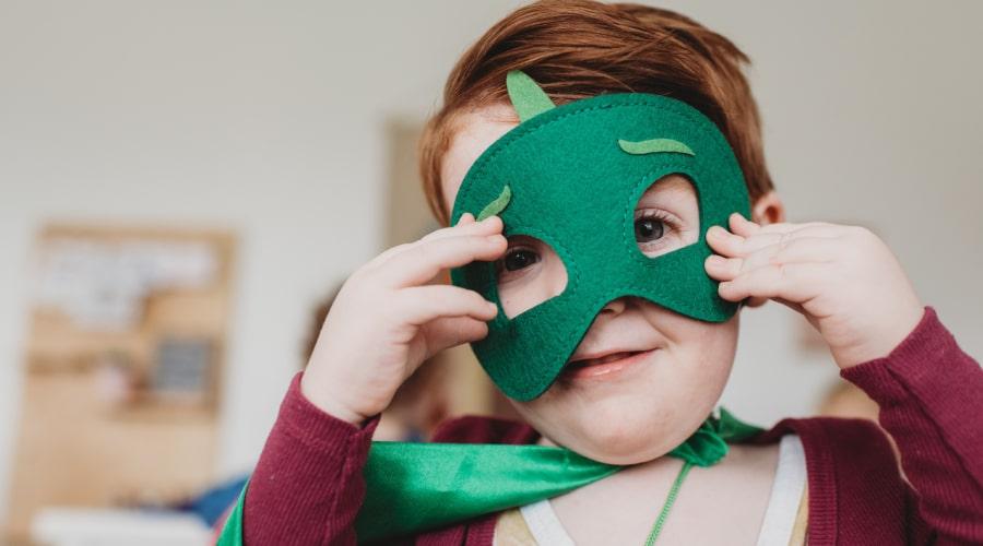 Boy playing superheroes