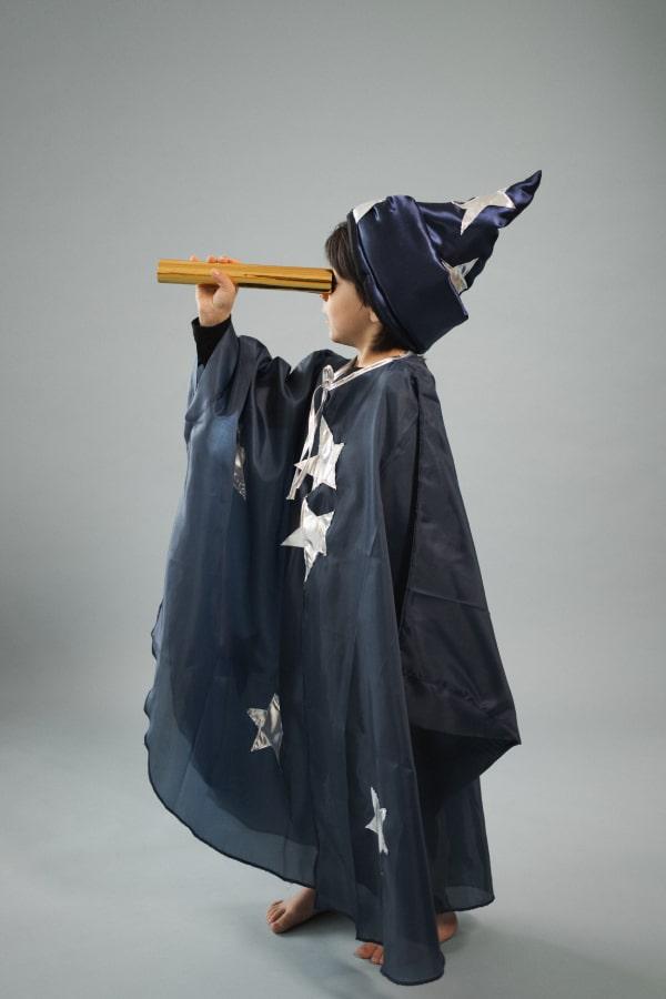 boy holding a telescope