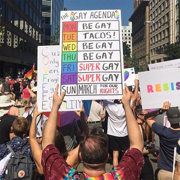 Gay pride sign that says gay agenda