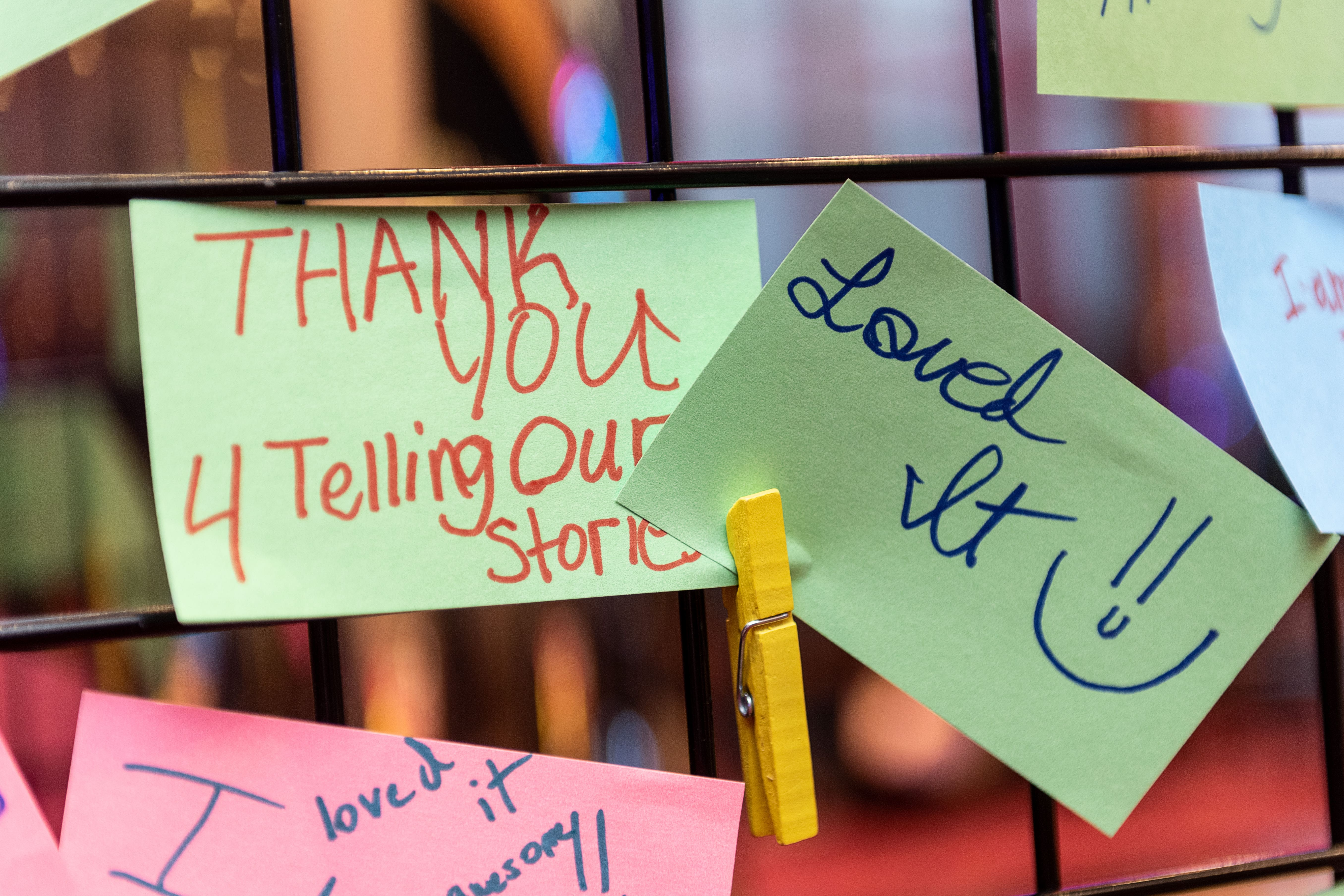 Handwritten green notecards saying Thank you for telling our stories and loved it