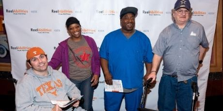Four people in front of a ReelAbilities call and repeat