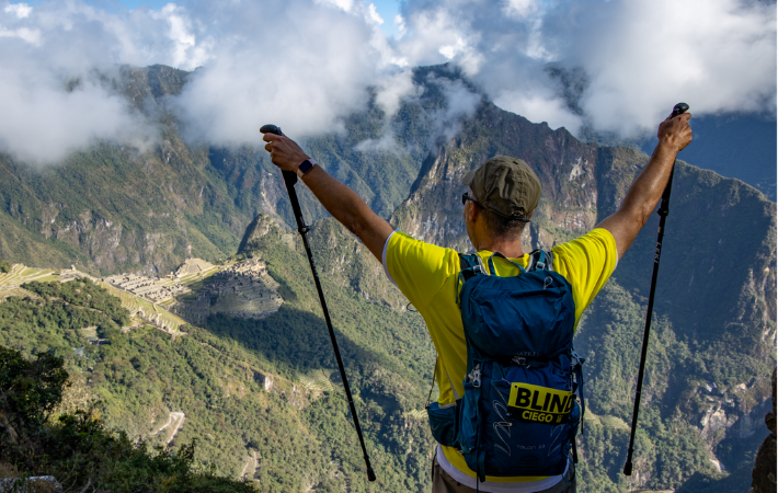 Michael McCulloch triumphantly stands in front of Machu Pichu