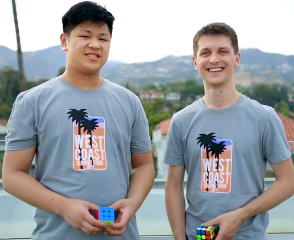 Max Park and Feliks Zemdegs wear matching tshirts and hold Rubix cubes