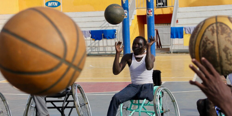 Malat Wei plays wheelchair basketball in a circle of friends