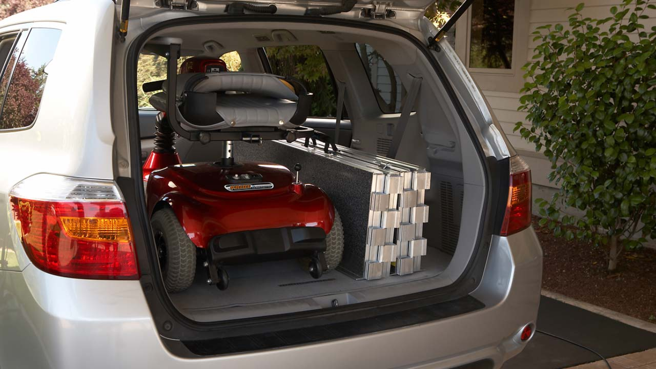 photo of SUITCASE® Trifold AS Ramp folded up in the back of a minivan