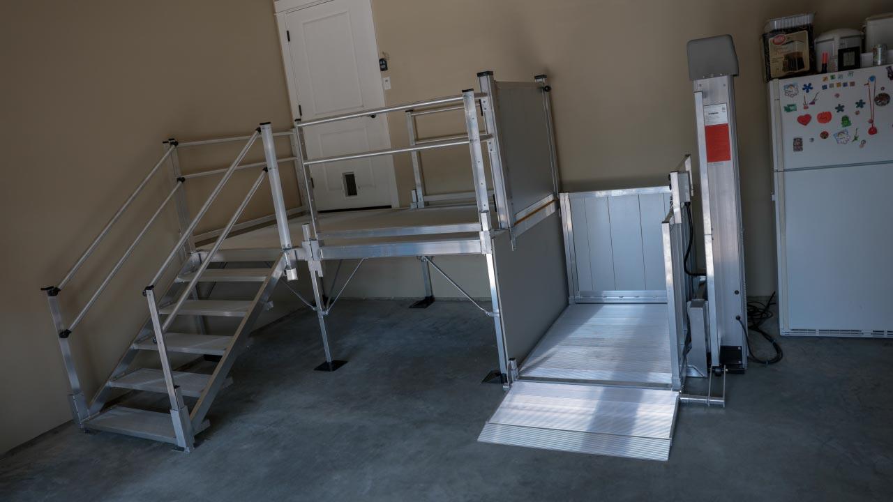 PASSPORT® Vertical Platform Lift in a garage setting