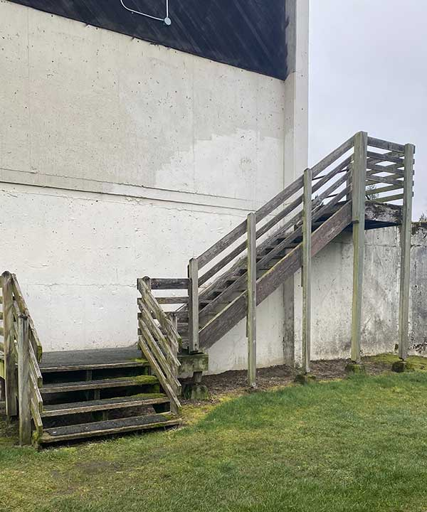 front view of worn out wooden stairs at a local school