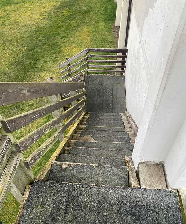 top down view of worn out wooden stairs at a local school