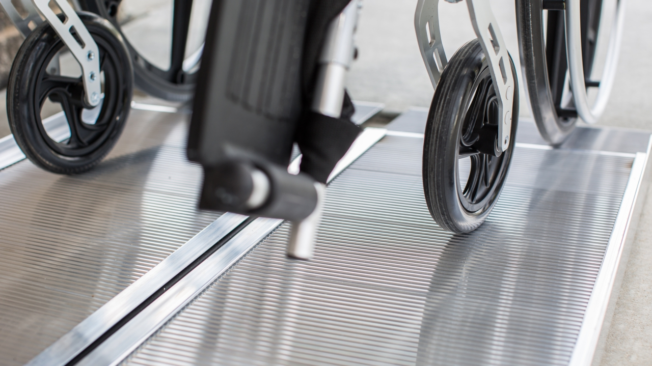 Wheelchair wheels on our Singlefold Ramp slip-resistant tread