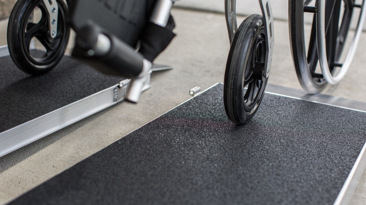 Wheelchair wheels on our Singlefold AS Ramp slip-resistant tread