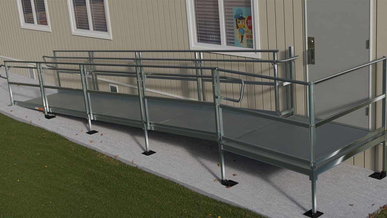 rendering of a TITAN ramp in front of portable classroom building