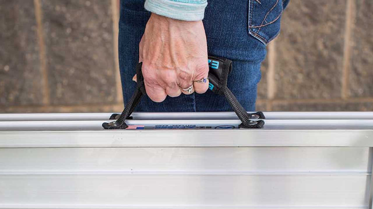 photo of SUITCASE® Singlefold AS Ramp being carried by using the ergonomic handles