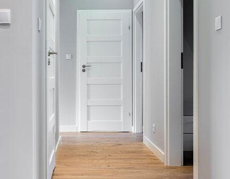wide hallway in home with doors