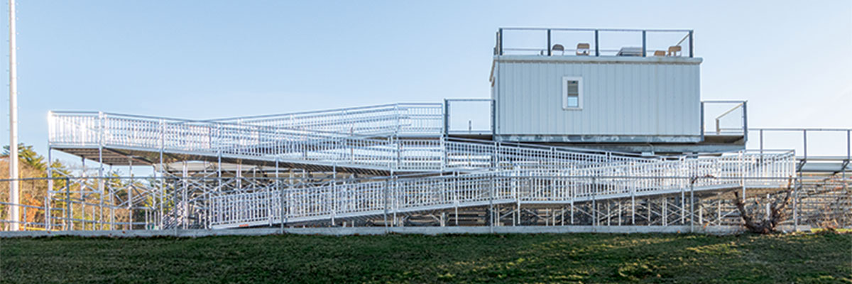 upper ramp structure leading to top of outdoor bleachers