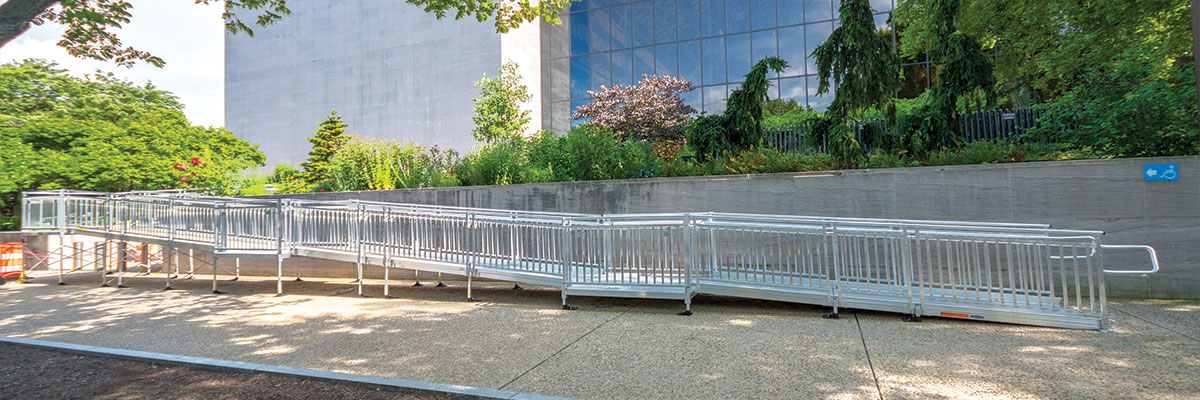 main entrance ramp extending onto sidewalk in front of Air and Space Museum