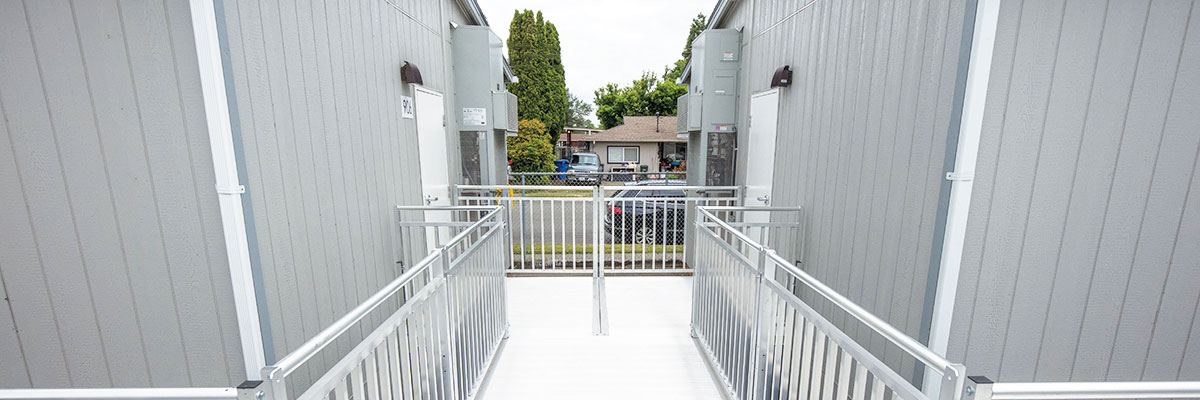 """TITANâ""""¢ Modular Ramp System connecting multiple outdoor portable classrooms with walkways"""