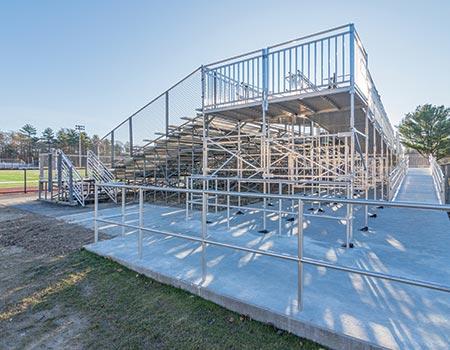 "Whitman-Hanson Stadium Bleachers side view with EZ-ACCESS TITANâ""¢ Modular Ramp leading to the top"