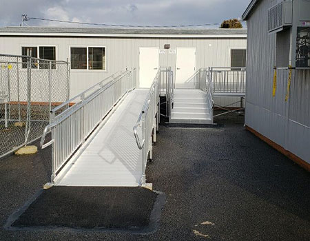 """straight TITANâ""""¢ modular ramp and stairs leading up to a portable classroom"""