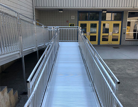 """TITANâ""""¢ Modular Ramp leading up to a permanent school building"""