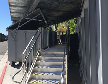 """TITANâ""""¢ Modular Stairs and platform providing access to dumpster"""