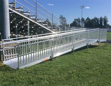 "TITANâ""¢ Modular Ramp providing access to stadium bleachers"