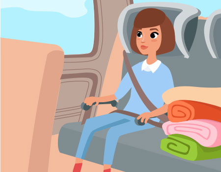 girl sitting in backseat with blankets next to her