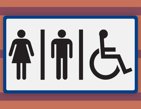 Accessible bathrooms sign on wall