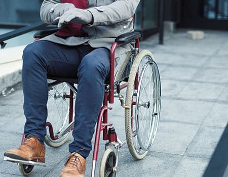 guy in wheelchair on concrete ramp in winter time