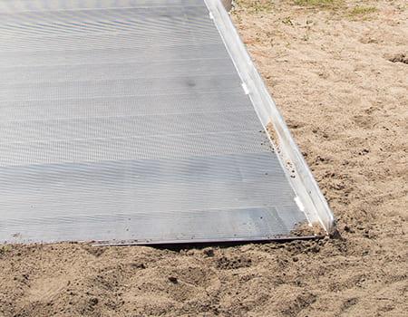 aluminum ramp end in dirt