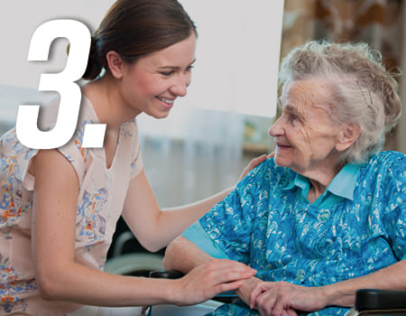 younger woman looking after an elderly woman