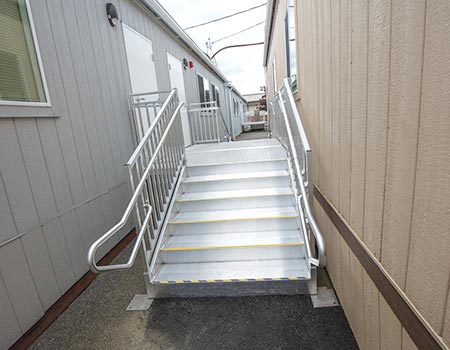 """TITANâ""""¢ stairs leading up to platform to multiple buildings"""