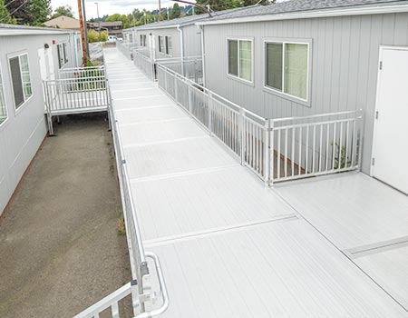 """TITANâ""""¢ ramp system outside of portable school with long platform leading to multiple portable buildings"""