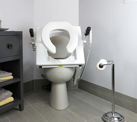 "TILTâ""¢ toilet seat in the upward setting"