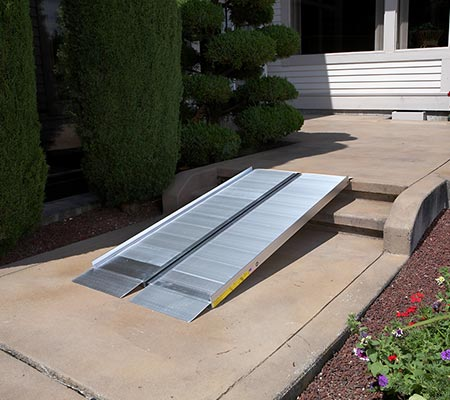 SUITCASE® singlefold ramp placed outside on steps leading up to a home