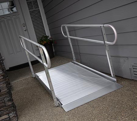 """GATEWAYâ""""¢ ramp with railings leading up front door step into home"""