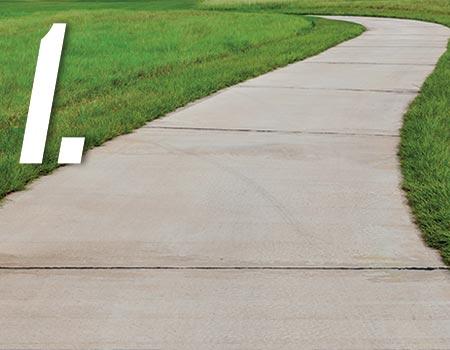 long smooth sidewalk in grassy field