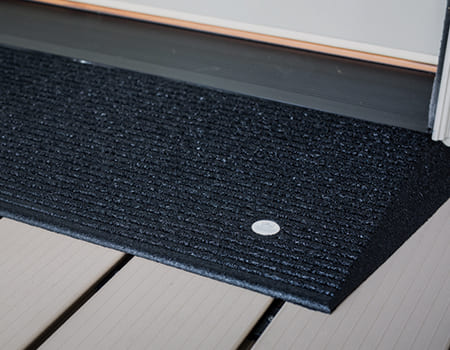 TRANSITIONS® Angled Entry Mat in doorway entry