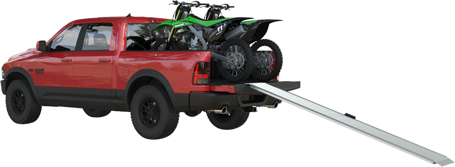 Dirtbikes loaded in a truck with ramp