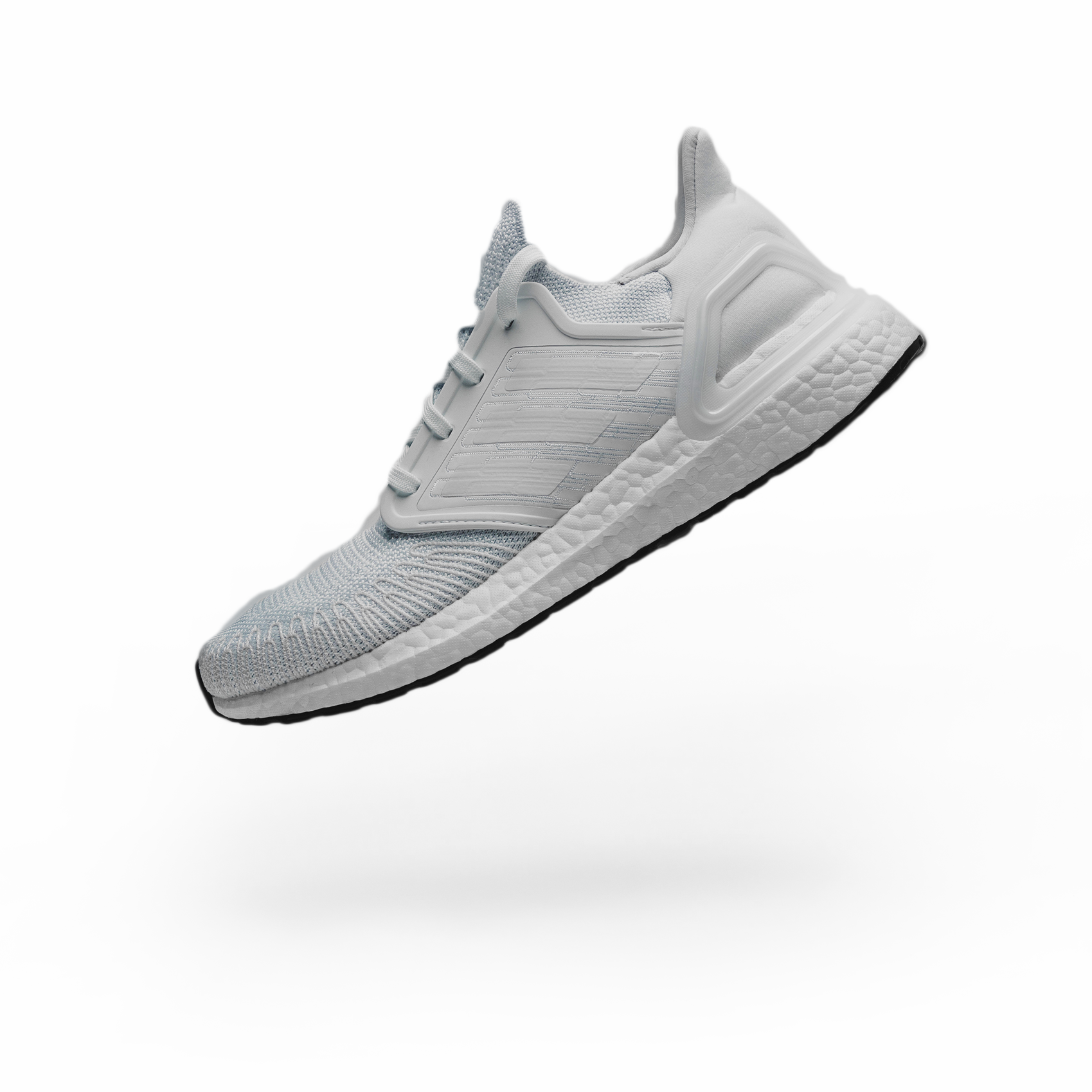 Single running shoe seen floating above the ground with the toe pointing to the ground and seen from the inner-ankle side of the show