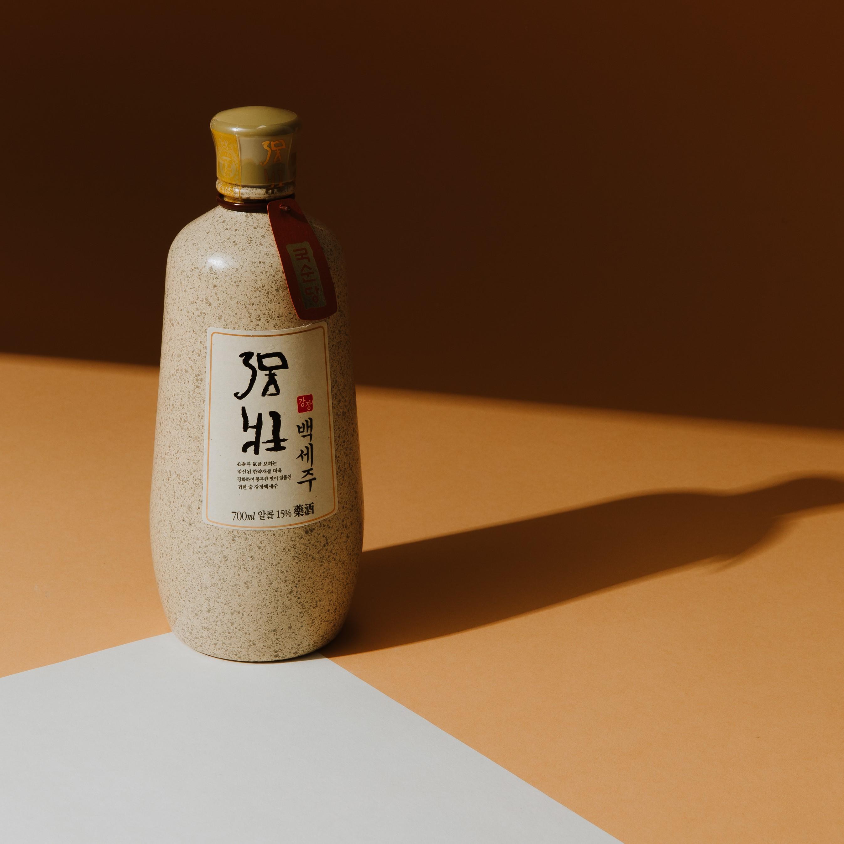cute bottle of soju shown on a wooden tabletop