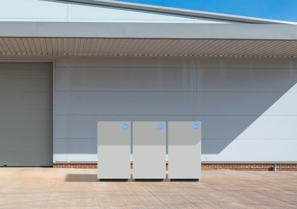 Three Exro 25kW 150kWh Energy Storage Systems outside a small facility.