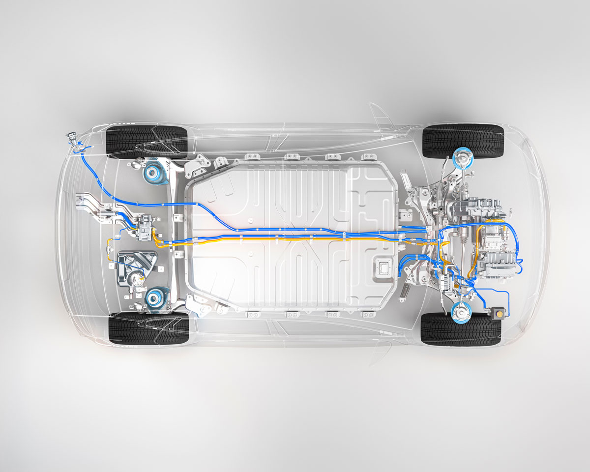 Top-down view of an electric car chassis, with the vehicle's battery and other inner parts visible.