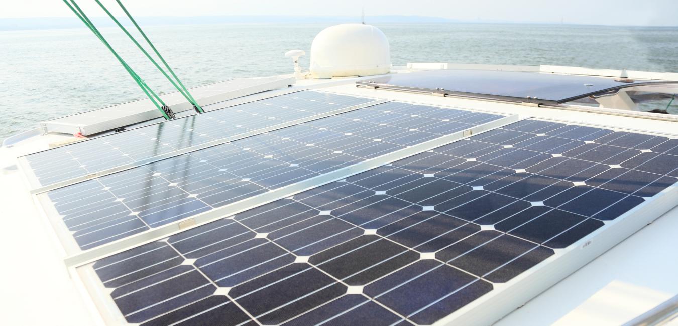 Solar charging battery panels powering a sail boat.