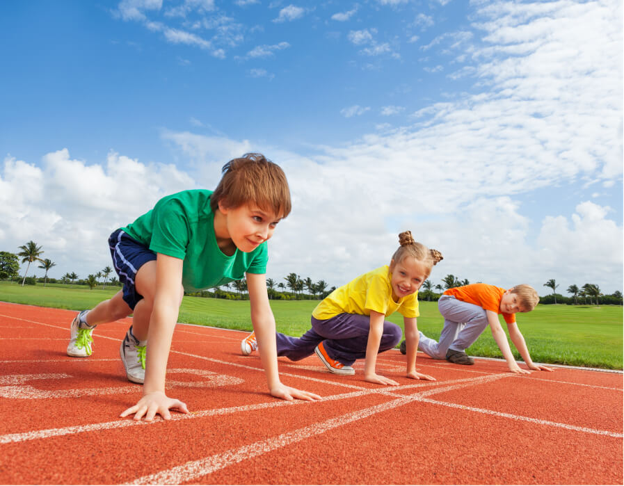Kids on a track starting line to represent the private school admissions process.