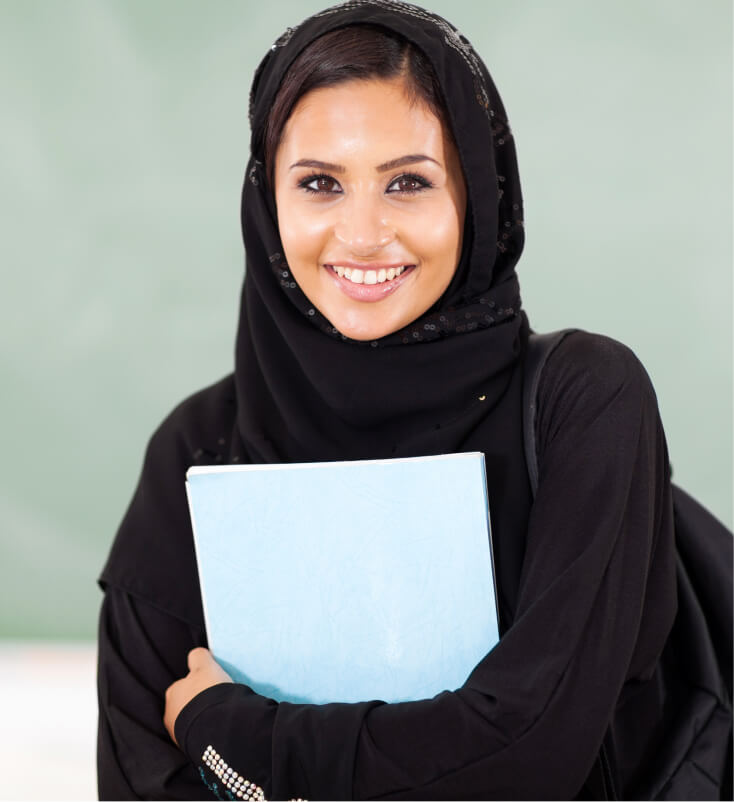 A female student coming into a classroom to take the SSAT paper test.