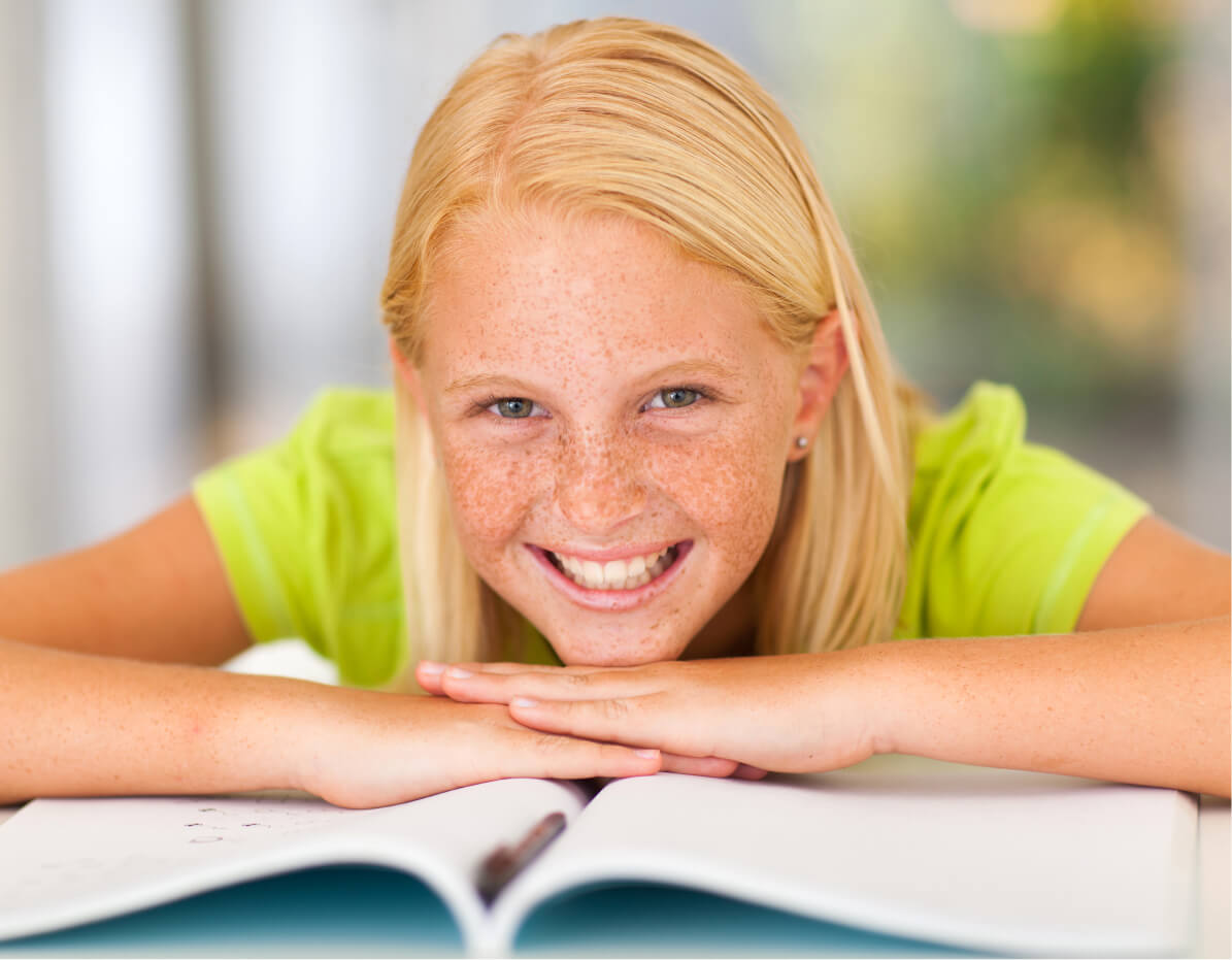 A middle school girl with her SSAT practice booklet.